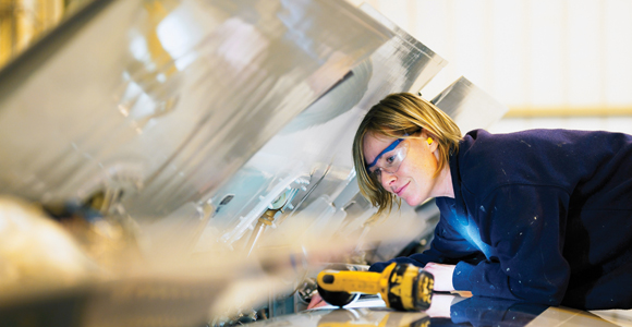 Young woman working in manufacturing