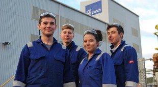 Apprentices standing outside Fabricom
